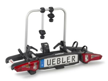 Uebler i21 bicycle carrier. Even smaller in size and also provides quicker and more comfortable attaching to the towing device. It is manufactured by the German company UEBLER